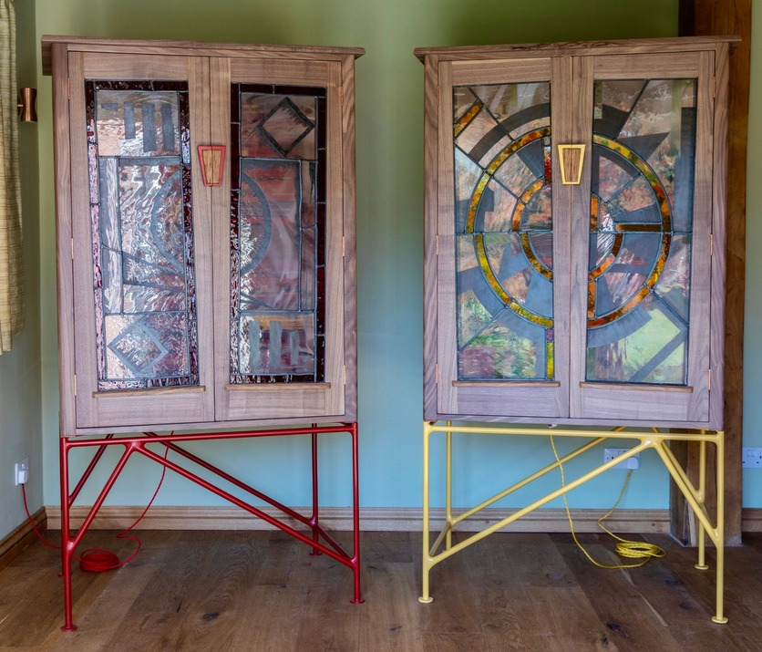 Tim Germain - A pair of gentleman's wardrobes in American black walnut and brown English oak with powder-coated steel legs (by Danny Sharp of Blunt Fabrications) and stained glass panels (by Danielle Hopkinson)